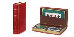 1950. This bridge set was designed to look like a leather bound book, like many products throughout the brand's history it was designed to look like one thing whilst actually being another.