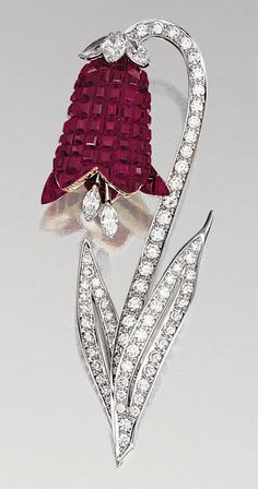 "RUBY AND DIAMOND BROOCH, ALETTO BROTHERS.  Designed as a bellflower, the stem and leaves set with brilliant-cut diamonds, the petals invisibly-set with calibrated rubies, to a marquise-shaped diamonds pistil set ""en tremblant"", mounted in yellow gold and platinum,    signed Aletto Bros, case."