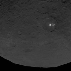 Dwarf planet Ceres: A cluster of mysterious bright spots on dwarf planet Ceres can be seen in this image, taken by NASA's Dawn spacecraft from an altitude of 2,700 miles (4,400 kilometers). The image, with a resolution of 1,400 feet (410 meters) per pixel, was taken on June 9, 2015.
