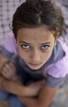 Haya Khalil, a beautiful syrian child, with the smile taken away even from her eyes. photographed by Muhammed Muheisen / AP Photo Read more here:. People Around The World, We The People, Syrian Children, Most Beautiful People, Brown Girl, World Peace, Fair Skin, Interesting Faces, Photojournalism