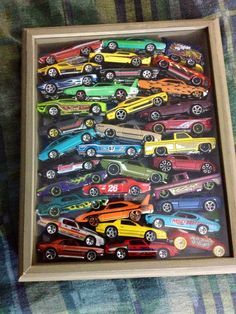 8x10 shadow box loaded with Hot Wheels, good way to store and display those cars that got unpackaged to play with! #hotwheels