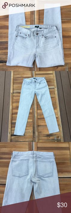 """J. Crew Gray Toothpick Skinny Jeans In a colored wash, these skinny jeans by J. Crew are an excellent staple piece. The light gray wash detail makes for a great item. Made from cotton and spandex. In good condition. Approximate measurements lying flat: 27"""" inseam. 20217 J. Crew Factory Jeans Skinny"""