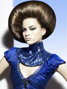 A long brown straight sculptured quirky avant garde hairstyle by Hooker & Young