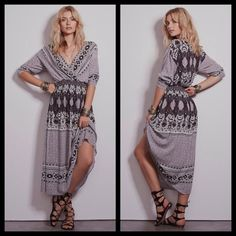 Free People Printed Midi Dress Size: S (I also have this in size XS). Color: Ivory Combo. Printed flowy midi dress with a V-Neck. Elastic band around the waist allows for an easy fit. Has a small sharpie mark on the tag. Free People Dresses Midi