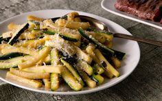 Sautéed Zucchini Recipe Side Dishes with garlic cloves, extra-virgin olive oil, red pepper flakes, zucchini, kosher salt, freshly ground black pepper, grated parmesan cheese