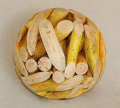 Yellow Wood Sphere. Looks like sliced bananas