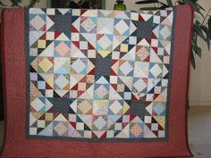 The first quilt I finshed back in 2001.