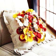 DIY yellow felt flower pillow on sofa - home decor, handmade felt pillow - LoveItSoMuch.com