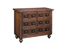Handsome rustic apothecary style accent chest with aged bronze embossed detailing on each drawer front. Features six working drawers, leather straps with nail head accents and a plank style top. Crafted from wood and wood veneer.