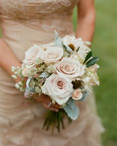 Callie carried a petite bouquet by Fleur de V of roses, astrantia, andromeda, and jasmine in muted tones indigenous to the surrounding environment at her Wyoming wedding.