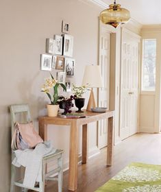 Entryway tip: for overhead lighting, suspend a pendant or a chandelier so that the bottom is six feet eight inches above the floor. If you hang it much higher, you'll lose its visual effect. And if you hang it much lower, you'll truncate the space.