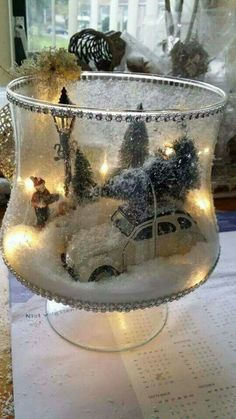 Winter holiday display ideas / Christmas home decor decorating / glass jar with faux snow, trees, car,etc.