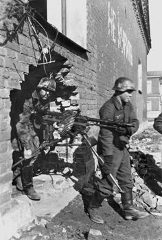 German soldiers redeploying a MG from a building...