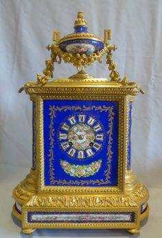 Antique French ormolu and hand painted porcelain on a cobalt blue ground. ca.1870.