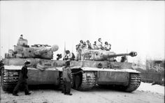 Tiger I number 221 and 224 of Schwere Panzer Abteilung 501 winter camo eastern front.