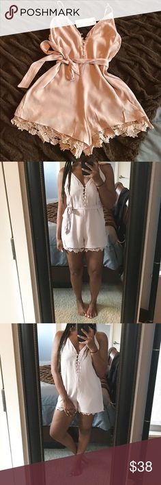 Adorable Lush Romper!! Super cute, neutral colored romper with lace trim along bottom hemline and on back. Button down front. Adjustable straps. Belt tie. Can be worn with or without belt. NWT! Lush Pants Jumpsuits & Rompers