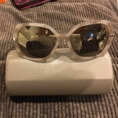 Authentic Burberry sunglasses - nude/gray New Burberry sunglasses.  Mirrored lenses.  Tiny scratch on meticulous inspection. Leather ear pieces.  B 4153-Q 3427/5A. 58 16 135 3N. Case is NOT Burberry but BCBG Max Azria and matches and fits perfectly.  Also comes with a new lens cloth. Burberry Other