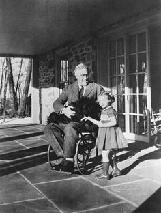 Franklin D. Roosevelt at Hyde Park in a Wheelchair Photograph, 1941 -- One of the few pictures showing FDR in his wheelchair.  He survived polio during the 1920s.