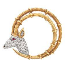 Gold, Platinum, Diamond and Ruby 'Ibex' Brooch, Tiffany & Co., Schlumberger  18 kt., 64 round diamonds ap. 1.25 cts., signed Tiffany & Co., Schlumberger, ap. 12 dwts.