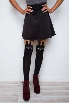 Insanely adorable! These Little Animal Tights feature a black, kitty cat design with sheer panels on the top. Stretch waist, seamed toe. Perfect paired with a skater skirt and pumps! *One Size Fits Mo