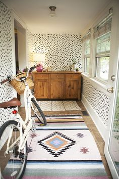 Achieve a high-impact hallway with the help of a dot stencil. #DIY