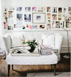Love the wall collage - although the look of the room is too feminine for me but very pretty.  I will use the idea of mixing one large print with smaller art work and pieces.