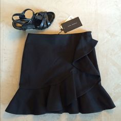 "Black Zara skirt.   NWT.  Host Pick 1/12/16! Brand new with tags. Zara Woman black skirt with ruffles along the bottom and up one side. Very flattering. Recently saw a gal wearing this and she looked cute.  I'm too big for this size.  52% cotton 45% poly 3% elastane. Perfect condition.  14"" across waist and 15"" from waist to hem.  This can fit a small as well considering the waist size.  Fabric is thickish and warm. Zara Skirts"