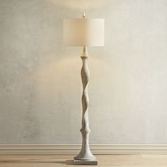 We love this fresh twist on a classic candlestick design. Our whitewashed floor lamp keeps things light and bright while its vintage influence provides visual interest for your family room, home office or bedroom.