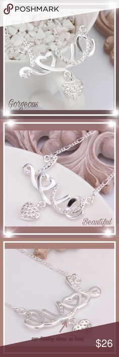 """Beautiful silver Love with hanging heart necklace Brand new , just came in , very gorgeous and creative romantic """"Love """"with beautiful hanging heart with Crystals in heart pendant and chain. Beautiful necklace.  925 Sterling silver stamp on back side of pendant you can see In picture above. boutique 24 Jewelry"""