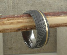Damascus Steel Wedding Ring with Off-Center 14K Yellow Inlay
