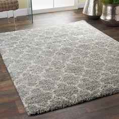 Sink your toes into this plush rug and enjoy the softness underfoot along with eye catching style from a classic Moroccan trellis pattern. Available in trending shades of Aqua, Gray, Black, Taupe, Cream and Ivory. Power loomed 100% polypropylene shag fiber is soft, colorfast, non-shedding and antistatic. Imported.