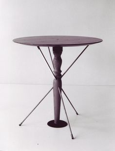 """""""San Sebastiano"""" is a demountable small table formed by a circular plan supported by a  wood column transfixed by three threaded bars."""