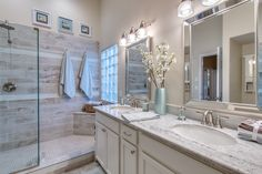 Gorgeous Upscale Master Bath Remodel with River White Granite, White Cabinets, and Exceptional Wood Look Tile Surround Set Off With Teal and White Accents