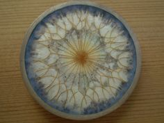 Dandelion Brooch by Ros Conway, Enamelling on silver, incorporating fine gold wires.