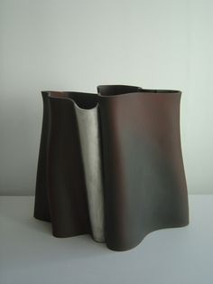 Kenneth C Eastman is an English ceramic artist, best known for his austere, flat bottomed, slab built ceramic vessels.