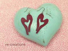 upcycling leather remnants, hand cut earrings in wine red, heart shape