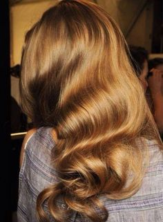 Back view of a girl with long wavy hair