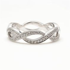Beverly K Diamond Twist white gold eternity band is decadently covered in pave diamonds and pairs perfectly with engagement rings or sits beautifully on its own. Diamonds: 0.43 twt (G Color, SI Clarity) $2175 I love the idea of the eternity symbol on the wedding band!