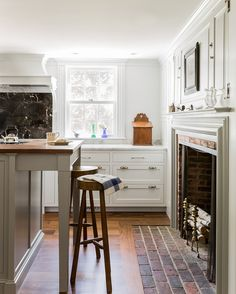 Colonial Farmhouse Kitchen with Fireplace