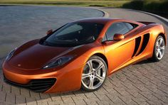 The 2013 McLaren MP4 12C gets a price hike to $241800 in the U.S with upgrade for power and other package.