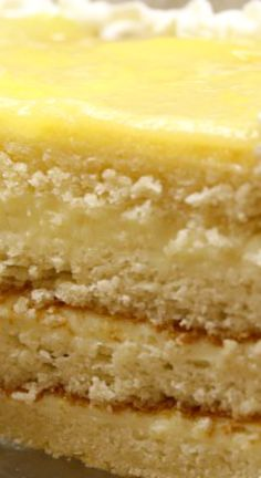 Lemon Truffle Cake ~ This delicious cake is layered with a creamy lemon-truffle filling that is amazing