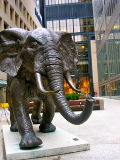 This mom elephant with her two babies can be seen in the courtyard behind King Subway Station in Toronto