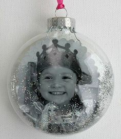 Photo Christmas Ornament: using a clear ornament, remove the top. roll a photo & slip inside; unroll with a brush handle or other similar tool. add a little glitter (the ornament can be shaken if glitter is stuck to the sides) & replace the top. tie on some ribbon & it's ready to hang! This would really be cute with their Christmas wish list for that year on the back of the picture.