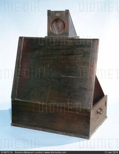 Folding wooden camera obscura, early 19th century. - stock photo