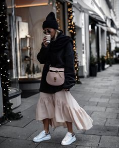 Blogger Style Tip: How to Wear Sneakers with a Midi Dress? If your wearing sneakers with a midi dress and want to that outfit that gets you all the compliment. Style your sneakers with a similar colour midi dress and chunky piece of knitwear that compliments the colour. The ultimate laid-back and luxe looking outfit. #Sneakers #Dress #Fall #outfits #FashionBloggers