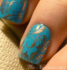 Pretty blue and gold nails.