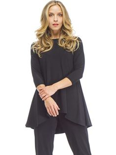 True T Elongating high neckline, 3/4-length sleeves, mid-thigh hitting hemline. Made from a smooth, matte jersey in Canada.