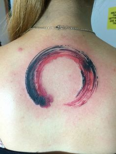 Red and black brush stroke enso circle tattoo from Pinktattoos. This is my first tattoo and I'm super loving it.