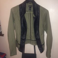 Blazer It's green with black leather . The collar have a zipper . Only worn a couple times ,I gain weight,so I'm selling it . Wet Seal Jackets & Coats Blazers