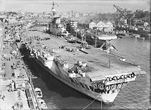 The Launching of the Aircraft Carrier HMS Indefatigable at Glasgow, Scotland, 8 December 1942 - HMS Indefatigable - Wikipedia, the free encyclopedia Royal Navy Aircraft Carriers, Uk Navy, Navy Ships, Submarines, Battleship, Military, Boat, Ww2, Sydney